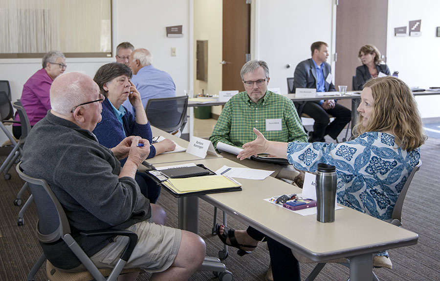 Members of the the Citizen-Business Working Group discuss long-term planning