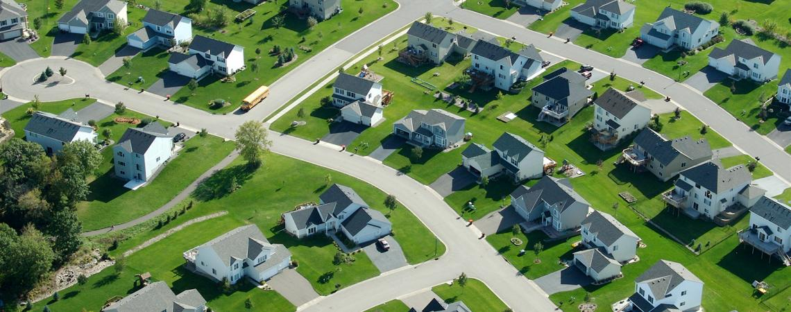 Aerial view of suburban neighborhood houses and streets.