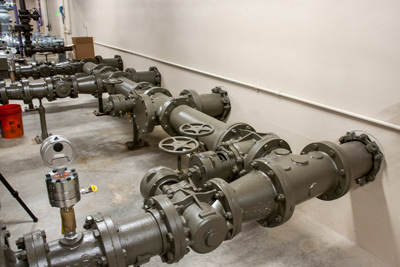 Large brown pipes with valves.